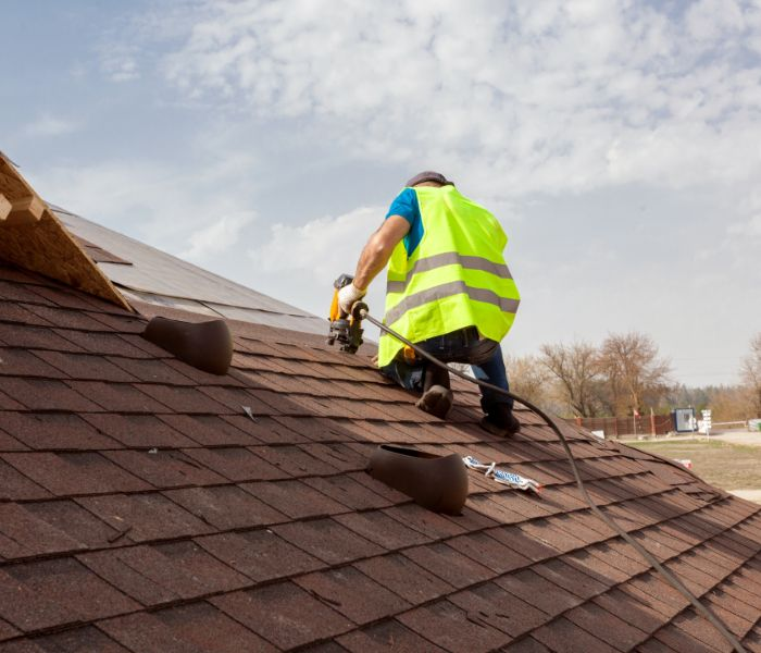 contractor from roof company doing roof repair in Sarasota
